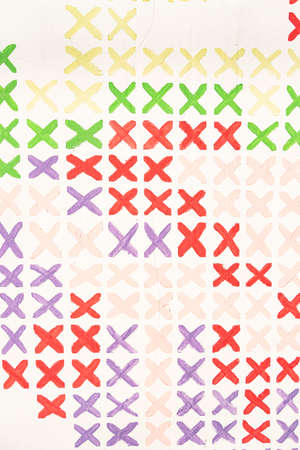 Colorful repetitive cross marks on white background Standard-Bild