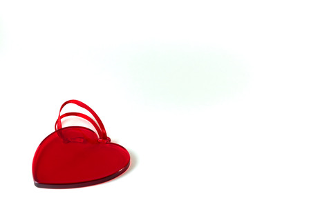 A red glass heart. Valentine's day concept. Copy space. Banque d'images - 115596720