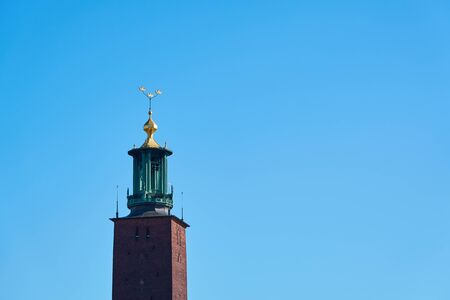 The tower of the city hall of Stockholm against a blue sky. Copy space.