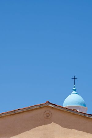 Rooftop of a church in Chania, Crete, Greece against a clear blue sky. Copy space.
