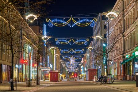 TURKU, FINLAND - January 01, 2021: Illumination on Christmas Street in Turku, Finland at night.