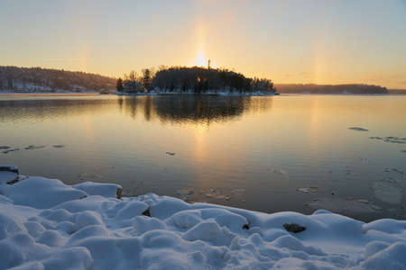 Halo effect of the sun on the shores of the freezing Baltic Sea.