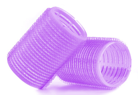 Set of two purple hair curlers isolated on white background Stock Photo