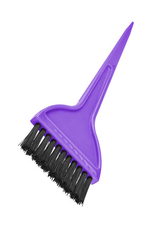 tilted view: Mauve dyeing hair brush isolated on transparent or white background, tilted view