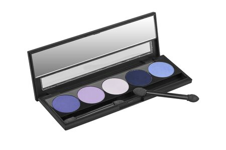 Five different colors solid eyeshadows set, in black flat box with mirror inside, beauty product isolated on white background, clipping path included