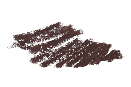 Brown color cosmetic eyeliner pencil strokes, beauty product sample isolated on white background