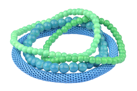 personal ornaments: Set of three green and blue elastic bracelets made of pearl-like round beads and one blue metallic elastic bracelet, isolated on white background, clipping path included Stock Photo