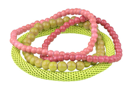 personal ornaments: Set of three red and olive elastic bracelets made of pearl-like round beads and one yellow metallic elastic bracelet, isolated on white background, clipping path included