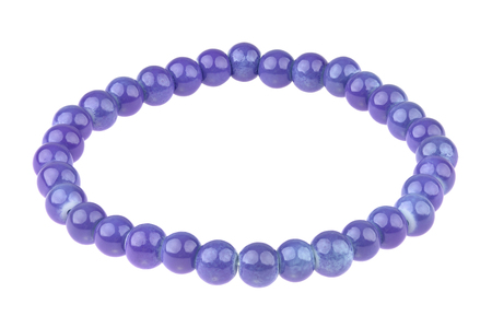 Purple blue elastic bracelet made of small pearl-like round beads, isolated on white background, clipping path included Stock Photo