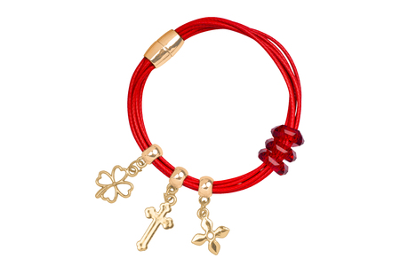 diamond stones: Red textile bracelet with golden ring and gold charms decorations, isolated on white background, clipping path included Stock Photo