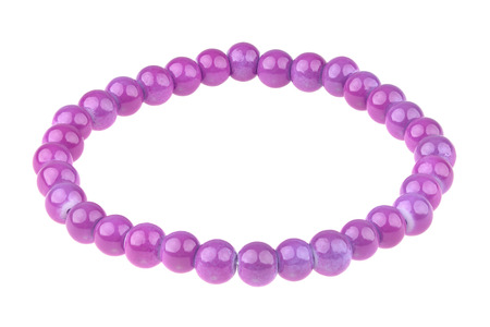 Purple elastic bracelet made of small pearl-like round beads, isolated on white background, clipping path included