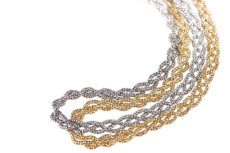 Close-up of two golden and silver metallic headband made of multiple weaved golden and silver  fibers, fashion item isolated on white background Stock Photo