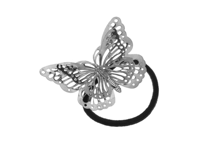 Black hair rubber scrunchy with big metal silver bow shaped like a butterfly, isolated on white background