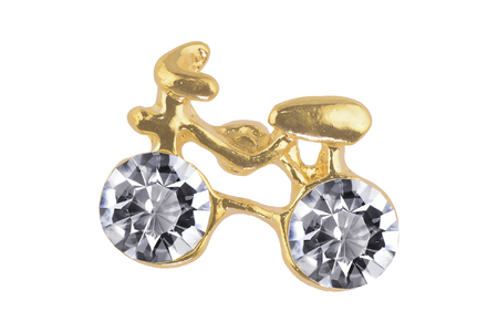 Close-up of funny golden earrings bicycle-shaped with two diamonds, isolated on white background, clipping path included