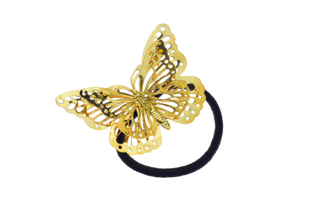 Black hair rubber scrunchy with big golden bow shaped like a butterfly, isolated on white background