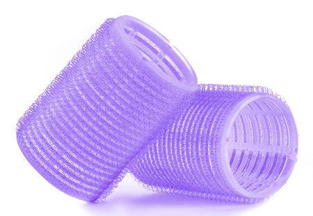 Set of two violet blue hair curlers isolated on white background Stock Photo
