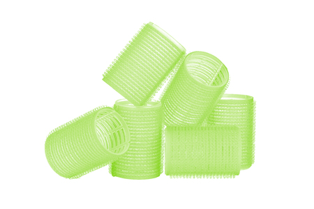 Set of six lime green hair curlers isolated on white background, with nice reflexion
