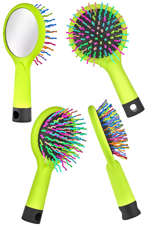 Set of four instances of a green hair comb brush for children, with handle and mirror on the back, isolated on transparent or white background