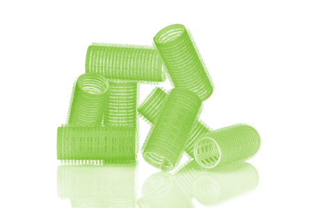hair roller: Set of eight acid green hair curlers isolated on white background, with nice reflexion. Stock Photo