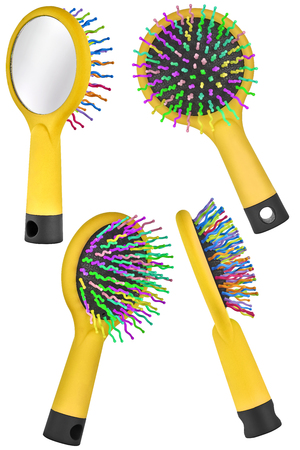 Set of four instances of a yelllow hair comb brush for children, with handle and mirror on the back, isolated on transparent or white background
