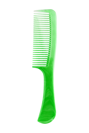 Green plastic comb with handle, isolated on transparent or white background