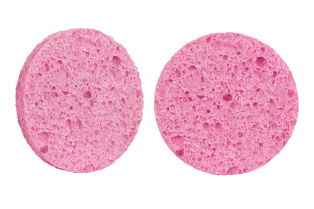 Two red round cosmetic sponge pads for face make-up cleaning, one frontal and one side view, isolated on white background, clipping path included