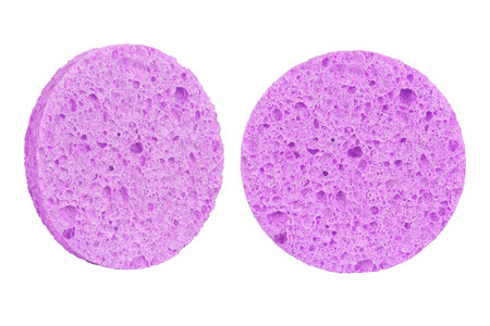 Two mauve round cosmetic sponge pads for face make-up cleaning, one frontal and one side view, isolated on white background, clipping path included Stock Photo