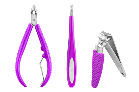 Three stainless steel nails care basic instruments with purple rubber cover: two-pronged dead skin scissor and cuticles pliers, cuticle pusher and nail clippers, beauty products isolated on white background Stock Photo