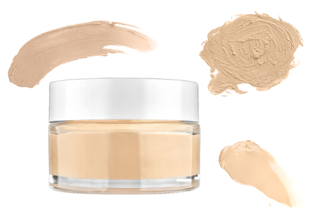 Nice glass face make-up creme foundation container and three smeared color samples, isolated on white backgroun