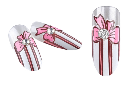 uñas pintadas: Funny fake nails with stripes, painted bow and a cristal in the middle, isolated on white background, clipping path included Foto de archivo