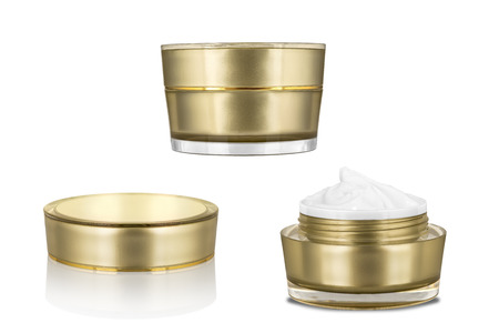Luxury cosmetic face moisturizing white cream for aged skin in open and closed glossy golden can with matching lid, isolated on white background, clipping path included