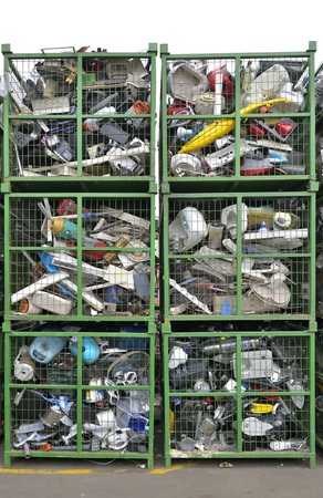 managing waste: Electronic devices components waiting to be recycled in a container, on a recycling plant site. Pile of sorted electronic garbage.