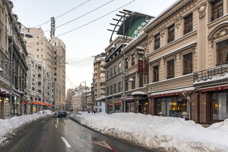 BUCHAREST, ROMANIA - JANUARY 11, 2017: Hotel and Restaurant Capsa in the downtown Bucharest, on Victory Avenue, close to the National Military Circle and hotel Capitol, after a heavy snowfall lasting a few days.