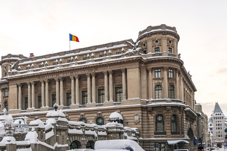 BUCHAREST, ROMANIA - JANUARY 11, 2017: The National Military Circle (Cercul Militar National) In Downtown Bucharest On Victory Avenue after a heavy snowfall lasting a few days, detailed view.