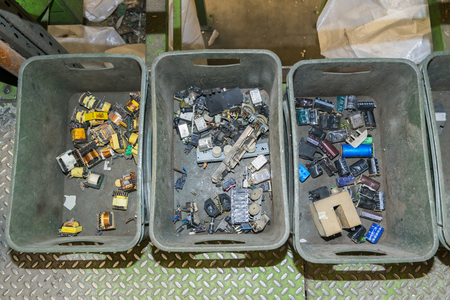 managing waste: Components of various electronic devices waiting to be recycled on a recycling plant site. Sorted electronic garbage.
