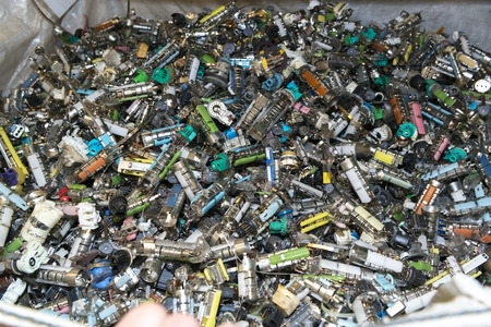 managing waste: Components of old used television sets waiting to be recycled on a recycling plant site. Sorted electronic garbage.