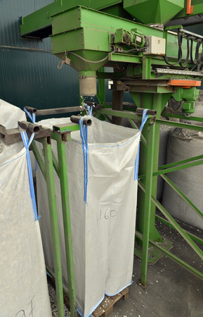 managing waste: Recycled plastic waste is cut in small pieces and separated in big bags, on a recycling plant