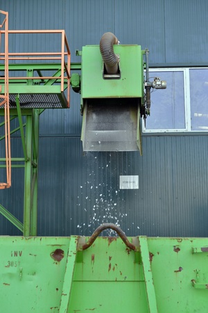 Recycled plastic waste is cut in small pieces and separated in containers, on a recycling plant Stock Photo
