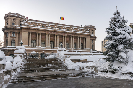 BUCHAREST, ROMANIA - JANUARY 11, 2017: The National Military Circle (Cercul Militar National) In Downtown Bucharest On Victory Avenue after a heavy snowfall lasting a few days. It was built in 1911 by architect Dimitrie Maimarolu, in French neoclassic sty