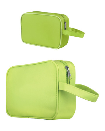 Green leather cosmetic and beauty bags, isolated on white background. Clipping paths included 免版税图像