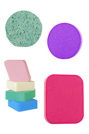 Cosmetic sponge pads for applying and cleaning face make-up, of different shapes and colors, isolated on white background, clipping paths included