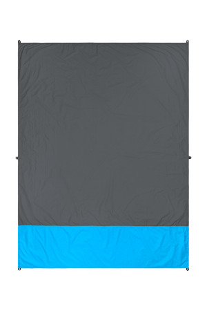 Waterproof and sandproof nylon beach blanket isolated on white background. Very thin tarp or footprint used for outdoor activities. Clipping path included. Imagens