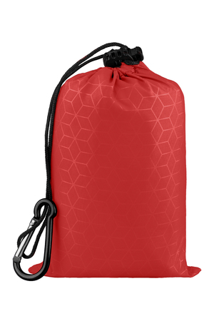 Very compact red nylon pocket blanket in a drawstring bag with a carabiner. Thin tarp or footprint for outdoor activities. Isolated on white background, clipping path included. Stock Photo