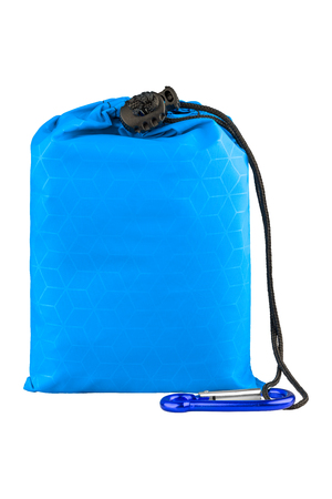 Very compact blue nylon pocket blanket in a drawstring bag with a carabiner. Thin tarp or footprint for outdoor activities. Isolated on white background, clipping path included. Stock Photo