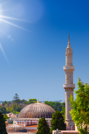 Minaret of the historic Suleiman Mosque in medieval City of Rhodes, Rhodes Dodecanese island, Mediterranean Sea, Greece. Summer holiday in the sunny hot Greece