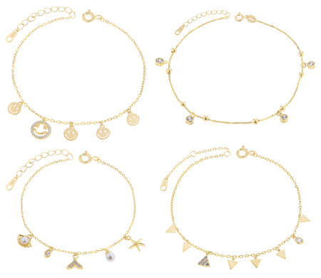 Gold charm bracelets with many charms, isolated on white background, with clipping path
