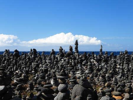Art of stone balance, piles of stones on the beach. Cairns on Playa Jardin, Puerto de la Cruz, Tenerife, Canary Islands, Spain. Stock Photo