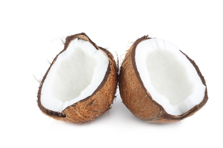 Two halves of coconut isolated on white photo