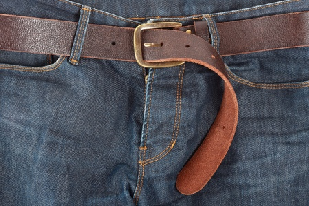 leather belt: Blue jeans with old brown belt Stock Photo