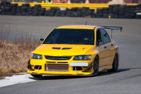 Yellow racecar on road